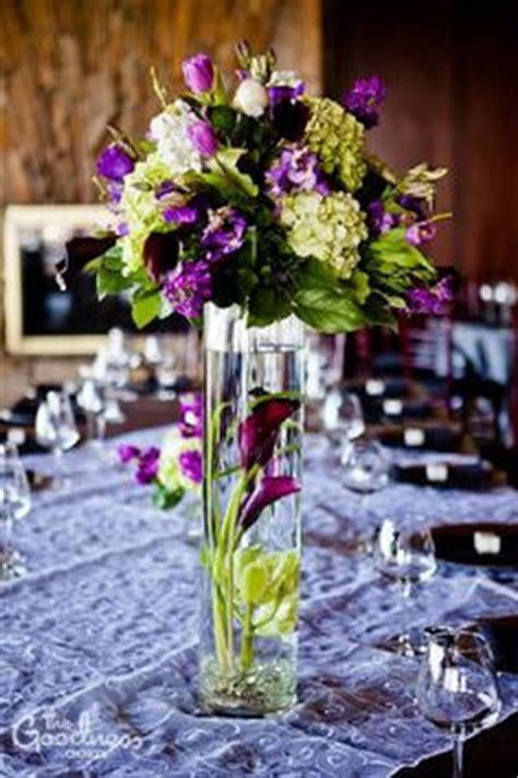 purple and green wedding centerpieces 1000 ideas about submerged flower centerpieces on flower centerpieces floating