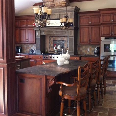 two tone cherry kitchen cabinets granite counters granite and cherries on