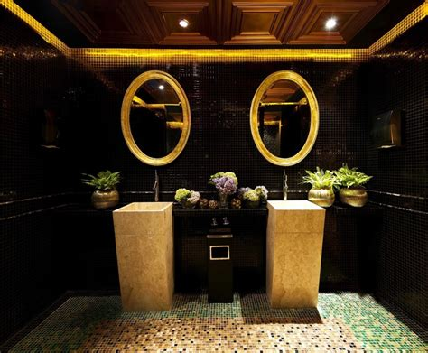 black gold bathroom a classy whiskey bar with skyline views of jakarta
