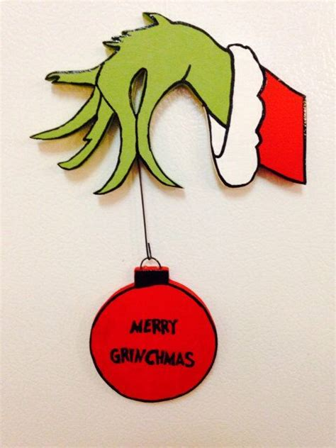 hand  grinch stealing  christmas ornament ornament   order family  merry
