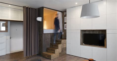35 square meters cleverly designed bed makes this tiny home feel bigger than its 35 square meter footprint