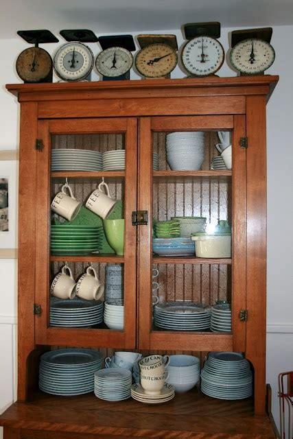 antique beadboard scales beadboard in back of cabinet wood and dishes