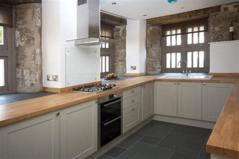 Howdens Kitchen Planner by Howdens Burford Grey With Wood Surface And Slate Grey