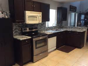 Kitchen Backsplash Glass Tiles silver cloud granite countertops with backsplash tiles