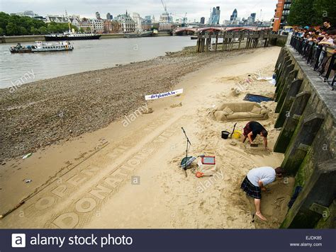 thames river bank sand sculpture on the thames river bank at low tide by