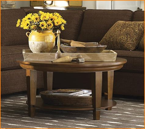 How To Decorate Your Coffee Table by Oval Coffee Table Decorating Ideas Home Design Ideas