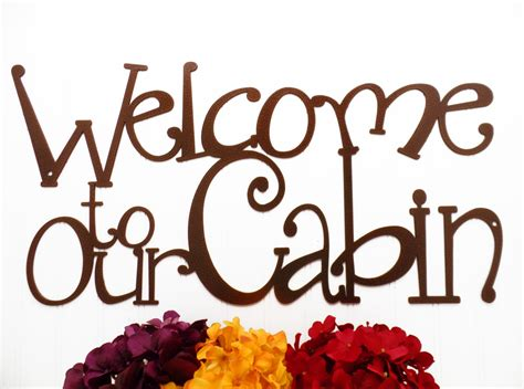 welcome to our cabin metal sign copper 24x12 metal wall