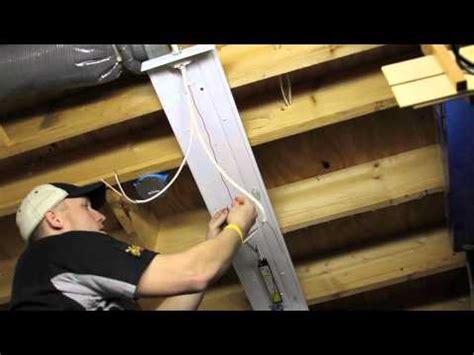 Installing Garage Lights by Installing Overhead T8 Light Fixtures