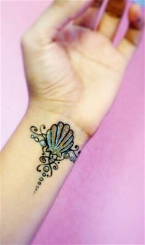 mermaid wrist tattoos this incredibly clever take on a mermaid s fin