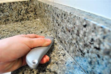 how to remove a granite backsplash removing the side splash backsplash from our bathroom