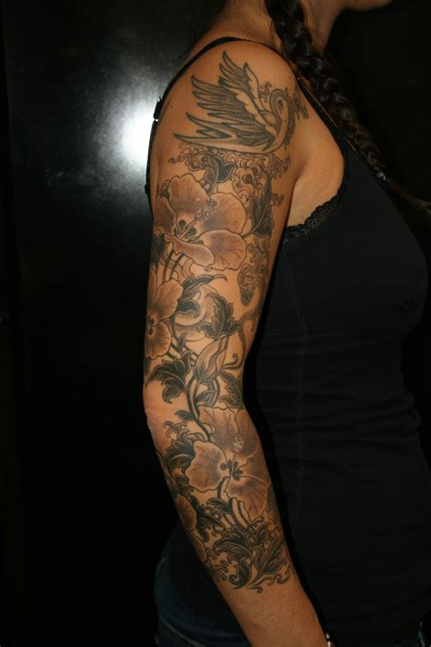 quarter sleeve arm tattoo flower sleeve tattooing art by yoni zilber