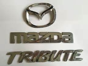 buy mazda tribute badges and emblems replacement parts