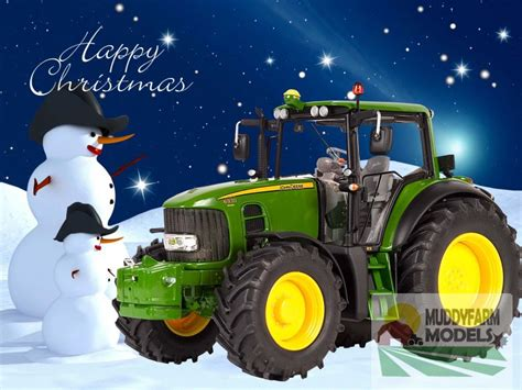 christmas cards showing model john deere tractor in snow