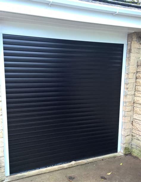 black thermaglide 77 automated roller garage door in