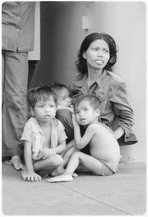 File:South China Sea....A refugee woman cares for three