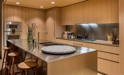 up modern kitchen oak cabinets and satin finish stainless steel make up this