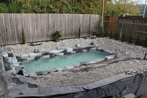 backyard swimming ponds this guy s ambitious project for his backyard actually ends up being amazing