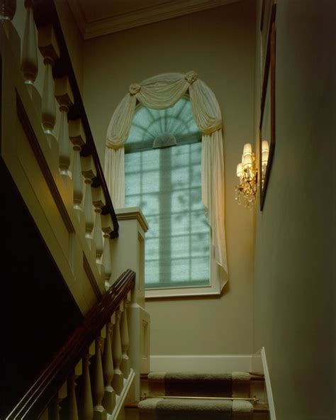 staircase window curtains arch window with shade and drapes traditional