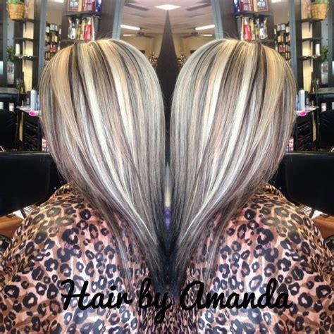 dark hair base with platinum highlights platinum highlights with a medium brown base platinum
