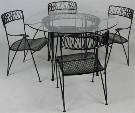 vintage 1950s modern dining table and chairs by tempestini