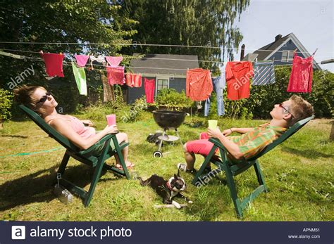 backyard sunbathers couple sunbathing in back yard stock photo royalty free
