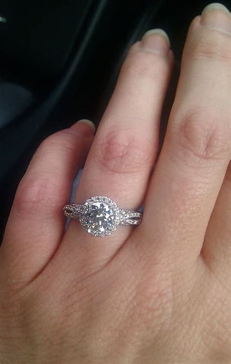 my engagement ring on my one proud happy excited