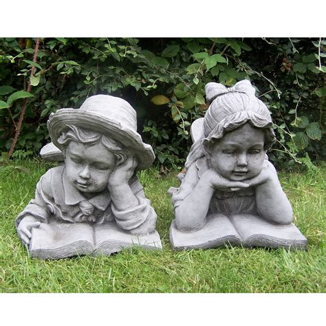boy and girl with book hand cast stone garden ornament
