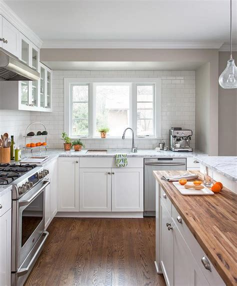 butcher block kitchen island breakfast bar white kitchen with glass front cabinets transitional