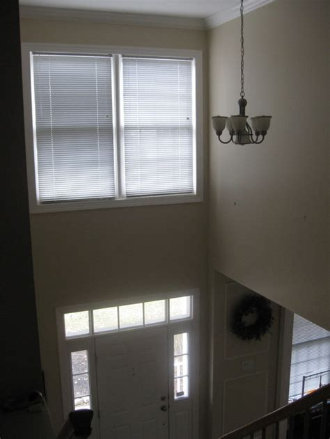 foyer lighting for 9 foot ceilings need help with 2 story foyer chandelier