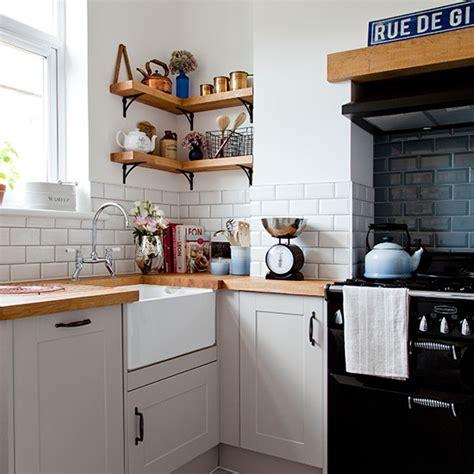 white kitchen ideas uk white kitchen corner with metro tiles and wooden worktop