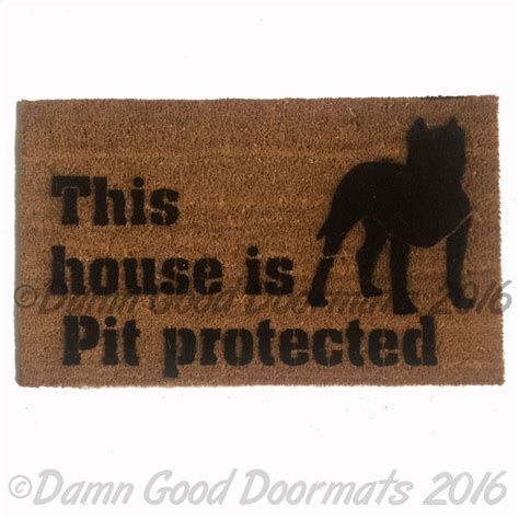 this house is pit protected doormat safety love dog door
