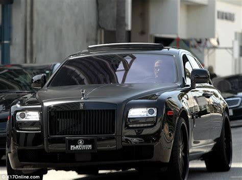 roll royce ghost all black david beckham is king of the road as he takes out his