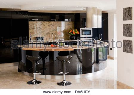 central island unit breakfast bar in modern country style pair of bomba bar stools at breakfast bar on glossy black