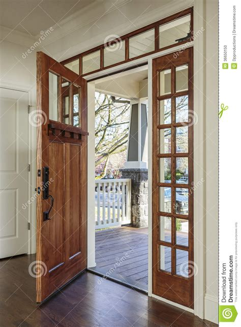 interior of an open wooden front door stock photo