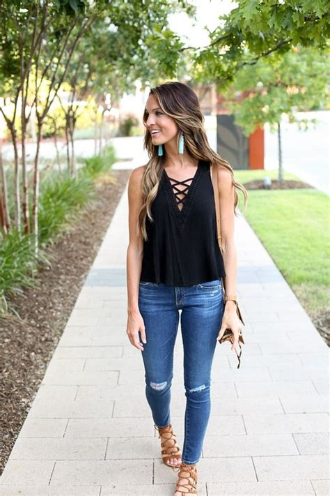 Picture Of ripped denim, a black top and lace up sandals