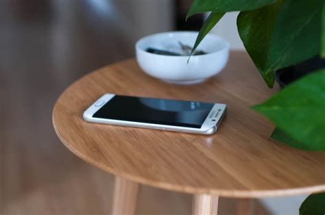 phone on the table furniqi bamboo qi wireless charging side table 187 gadget flow