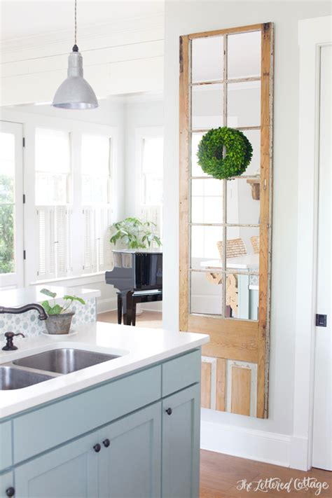 the lettered cottage kitchen kitchen update antique door turned wall mirror
