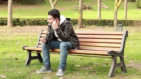 sad bench a sad man sits alone on a park bench stock footage video