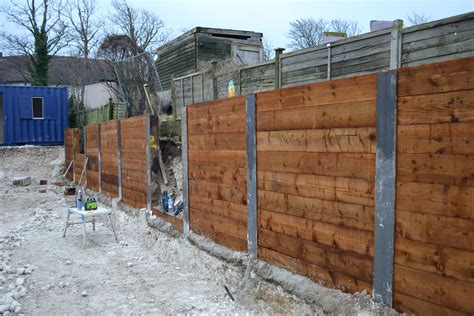 Steel Posts For Sleeper Retaining Wall by Last Bay Of The King Post Retaining Wall Goes In