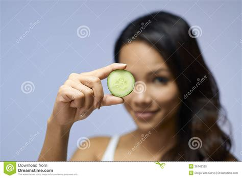 girl with cucumber asian girl using beauty cream and cosmetics royalty free
