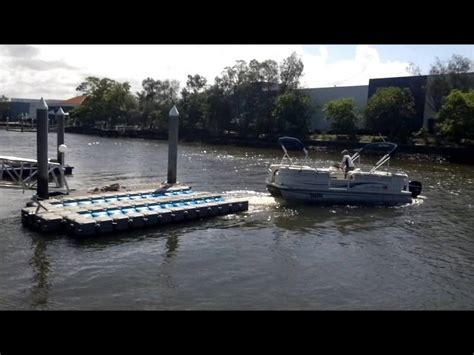 how to dock a pontoon boat in a slip pontoon boat dock youtube
