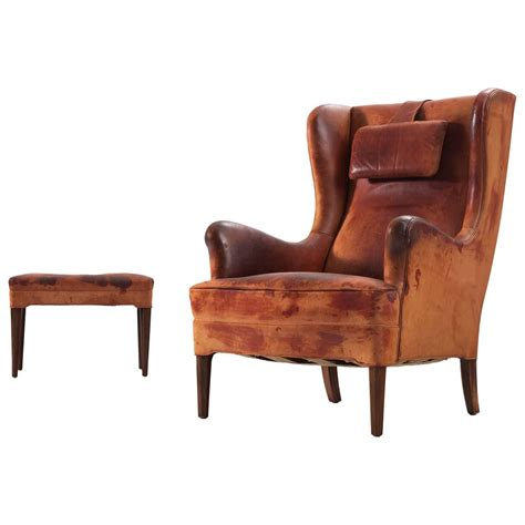 cognac leather wingback chair frits henningsen wingback chair and ottoman in original