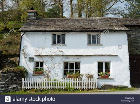 buy house lake district a traditional painted house with a slate roof in the lake district stock photo