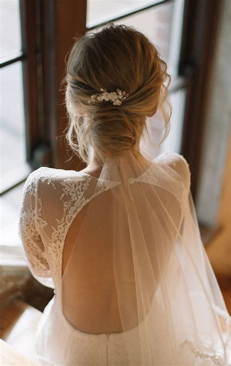 Wedding Hairstyles With Veil And High Bun by Flying High Wedding Veils Above Or Below The Bun