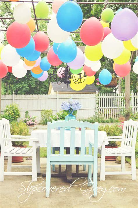 Outdoor movie birthday celebration slipcovered grey