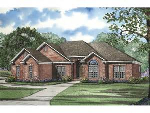 house plans rancher fernleaf ranch home all brick ranch house with multiple gables and an arched window from