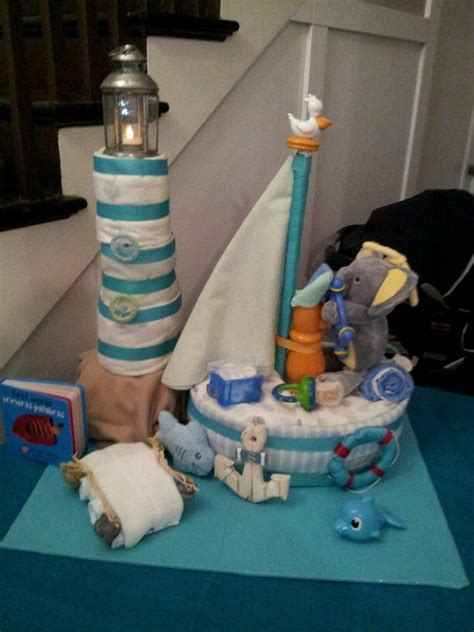 how to make a boat shaped diaper cake sailboat and lighthouse diaper cake made for nautical