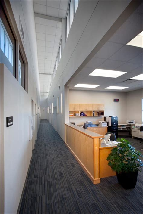 School Office Administrator by Mandeville High School Administration Addition
