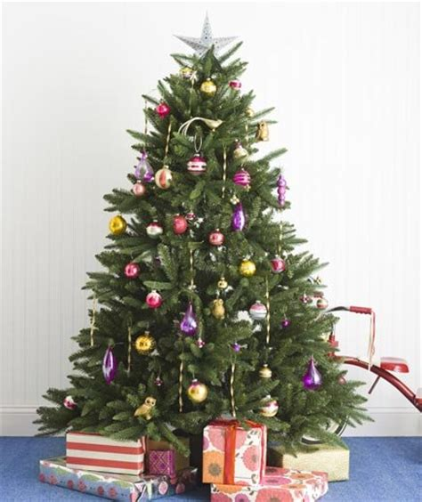 simple but beautiful christmas tree pictures how to mix the with new festive tree decorating ideas real simple