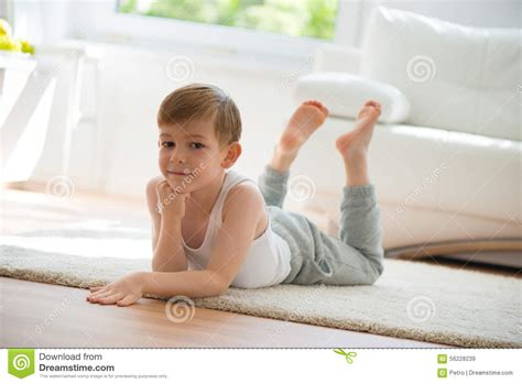 2 Floor Home Plans by Cute Little Boy Lying On Floor Stock Photo Image 56228239